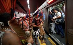Indigenous people prepare to board an underground train as they commute to the People's Summit for Social and Environmental Justice in Defence of the Commons, a parallel event during the UN Conference on Sustainable Development, or Rio+20, in Rio de JaneiroPicture: Felipe Dana/AP