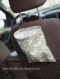 Trash bag for the car- I am so doing this.