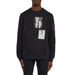 <a href='http://www.mrporter.com/mens/Designers/Givenchy'>Givenchy</a>'s cotton-jersey sweatshirt is cut in a classic crew-neck silhouette in the label's flattering 'Cuban' fit. It's embellished with printed appliqués in a nod to the label's street style-inspired aesthetic. The softly brushed fleece interior creates a comfortable and cosy feel. Team yours with tonal trousers and colour-pop sneakers.