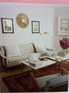 Vintage printed rug adds interest to neutral palette of furniture.  Table duo steps in for coffee table.