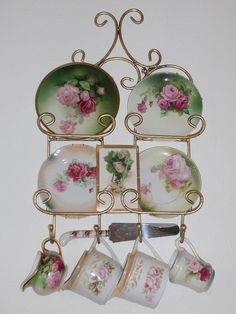 Vintage rose china wall display; No Victorian vintage kitchen is complete without these colors; wonder how to transfer these designs to decals for cabinets and wall paper??