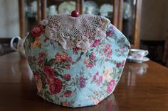 Shabby Chic Rose Floral Print Insulating Fabric Tea Cosy / Cozy with Vintage Crocheted Doily Trim and Custom Polymer Clay Bead Pull Top $50.00 CAD