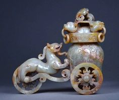 Chinese jade dragon chariot, Han Dynasty 汉代玉.  A rare and superbly carved Han Dynasty dragon chariot with spirit faces.