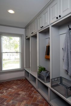 Fixer Upper hosts Chip and Joanna Gaines created a new laundry and mudroom for the homeowners, complete with plenty of storage cabinets, shelving, and coat hooks.