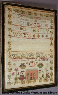 Framed Antique cross stitched sampler created by Jeannie Johnston Mortlach.