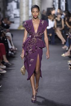 Elie Saab Couture Fall 2016 ph Giovanni Giannoni split on leg like would be on a single wrap peplos, belted wait as girdle and the peplum. also the metalic embrodiery could be reflective of the carved metal fibulae brooches