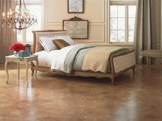 Using laminate is a low-cost, yet stylish flooring option. Made to resemble hardwood, stone and tile, laminate gives inexpensive options for texture, style and color.   Photo courtesy of Mohawk Flooring