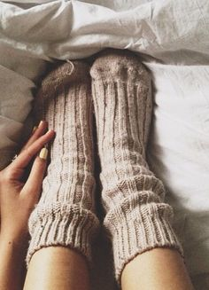 Cozy socks make us want to snuggle in bed all day.