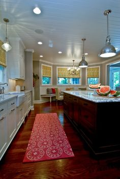 beadboard ceiling, recessed lighting, white shaker style cabinets, dark wood floors