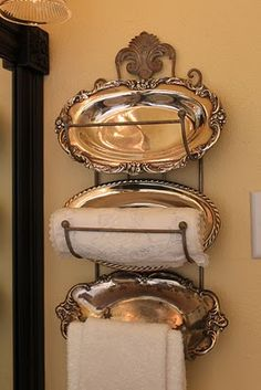Great Idea ~ Use heirloom silver platters and a wine rack to make a towel rack for the bathroom.