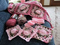 """From:  Nancy's Nice Knots of Crochet:  Using Red Heart Super Saver yarn in Baby Pink, Pink Camo, and Light Raspberry.  and """"H"""" crochet hook and this pattern:  http://www.ravelry.com/patterns/library/free-smoothfoxs-charity-square-nbr-2"""