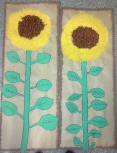 Pakkauspaperille valmisväreillä maalattu auringonkukka. (2.lk) Keskusta ruskeaa silkkipaperia.