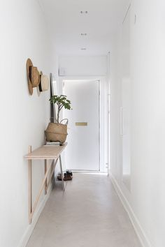 Richard Lindvall designed this shallow ledge table in his own entryway, seen on Fantastic Frank. Combined with the large leaning mirror, it's the perfect solution for a long narrow entryway where little else could fit. A few hooks top everything off. Hallway Inspiration, Interior Inspiration, Decoration Hall, Decorations, Narrow Entryway, Entryway Console, Hallway Storage, Hallway Shelf, Dark Hallway