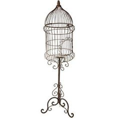 """Add an elegant, vintage touch to your home decor with this Iron Birdcage from Cracker Barrel. It's 38"""" of classic style perfect for any corner of the house."""