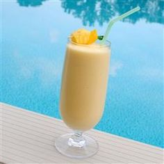 Mango Pina Colada Smoothie  (1 mango - peeled, seeded and cubed   1 1/4 cups ice cubes   2 tablespoons white sugar   1 1/4 cups pineapple juice   1/2 cup heavy cream   1 (14 ounce) can coconut milk)