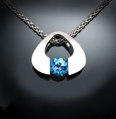 Argentium silver and Swiss blue topaz pendant designed by David Worcester for VerbenaPlaceJewelry.Etsy.com