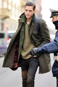 Great use of military theme in a pedestrian setting. Army green coat, shirt and sweater.  The half-shaved style haircut makes the outfit. #2013Trend