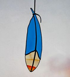 Now this is a sun catcher I have to have - actually a cluster hanging together would be gorgeous. Classic Stained Glass Feather