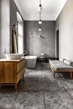Le gris domine dans cette salle de bains design