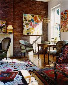 Living room with exposed brick wall, Kim Parker Gallery. http://www.facebook.com/kenisa.home