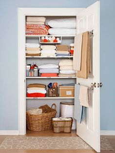 """still love this linen closet.just wish my linen """"closet"""" was an actual closet with one door and not 3 separate cabinets.Use a towel rod on the inside of the linen closet for holding blankets. Linen Closet Organization, Organization Hacks, Closet Storage, Organizing Ideas, Organising, Bathroom Organization, Bathroom Storage, Bathroom Towels, Airing Cupboard Organisation"""