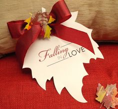 """Cut """"wish paper"""" for guests into leaf shaped pieces to later paste into scrapbook of wedding."""