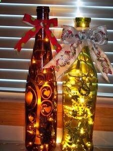 I love this idea! Etch wine bottles with glass etching solution and add lights and a bow. Voila Festive!
