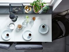 Seen from above, two side-by-side drop-leaf tables easily have room for coffee for three