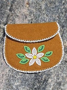 This coin purse is beautiful. Crafted by Dene artisans in Northwest Territories it is made of stroud European cloth traded in the Arctic for centuries. It features unique beadwork and youll find lots of uses for it. Measures wide x 4 high cm x 10 cm). Native Beading Patterns, Beadwork Designs, Native Beadwork, Native American Beadwork, Beaded Jewelry Patterns, Beaded Purses, Beaded Bags, Beaded Moccasins, Bead Sewing