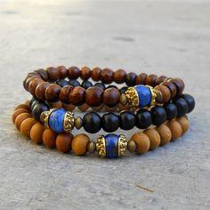 Compassion - genuine Lapis Lazuli guru bead sandalwood, ebony, and wood beaded bracelet set of 3, wrist mala, yoga jewelry, men. $49.00, via Etsy.
