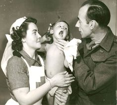 Canadian medical doctor and Red Cross nurse examine a child patient, February 5, 1946.
