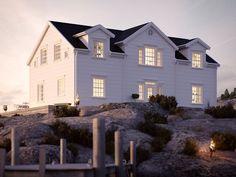 Hilton Head | Ocean Living | Ett hus med förhöjt väggliv i New Englandstil.
