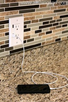 We switched out our regular outlet for a USB outlet for a quick and convenient way to charge our iPad, iPhone, and iPods - no adapter needed!