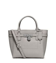 A carryall for all seasons, our Hamilton Traveler tote is as practical as it is chic. Inspired by heritage design, this piece features leather belting and a signature lock and key. The interior is complete with a number of zip compartments and pockets for fabulous functionality.