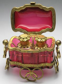 Antique cranberry glass perfume bottles and box