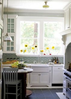 light green subway tile in kitchen-white cabinets. yesssss.