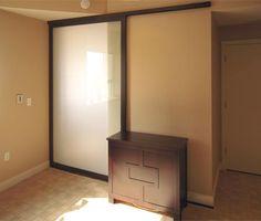 Sliding door for a bedroom/office combo space.