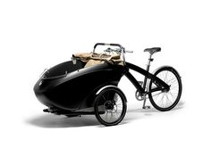 Triobike from Denmark, is ideal for those wanting to take their children to school safely and quickly, with two seats in front. It also functions as a simple bike, and can be used to transport objects. The trioBike carries up to 80 kg load, or the eq Microcar, Sidecar, Electric Cargo Bike, Electric Scooter, Vintage Cars, Antique Cars, Concept Motorcycles, Ideal Tools, Green Life