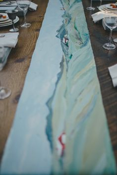 painted table runner for the reception // photo by With Love and Embers // design by Momental Designs
