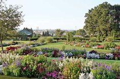 A rich tapestry of colorful annuals celebrates the summer season. Hershey Spa, Disney Garden, Great Wolf Lodge, English Gardens, Unique Gardens, Garden Features, Garden Photos, Garden S, Outdoor Entertaining