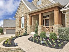 Beautifully landscaped path to front door and porch 2617 Izoro Bend, Cedar Park Texas 78613