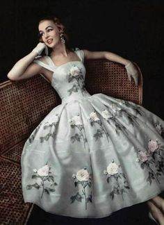Model wearing a dress with a rose motif by Givenchy, for L'Officiel, 1956.