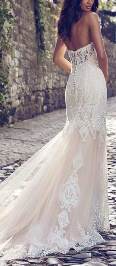 Maggie Sottero - AUTUMN, Beaded lace motifs cascade over tulle in this fit-and-flare wedding dress, accenting the illusion plunging-sweetheart neckline and illusion scoop back. Lined with shapewear for a figure-flattering fit.