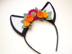 Make your little ones outfit a little brighter with this floral felt head band!  This item is made to order. Please allow 5-7 business days for production.  This listing is for one Felt Deer Ear headband - fuchsia, orange and yellow flowers with glitter gold and green leaves.  We love seeing your little ones in their new accessories so please send us photos or tag them on Instagram with #littlebloomsandbows
