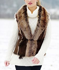 Add a layer of elegance to cool-weather looks with this sumptuous faux fur vest secured with a tassel-trimmed waist tie.