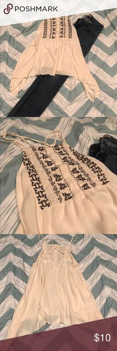Womens XS beige strappy sharkbite tank top boho Super cute top by Maurice's, size XS. It is an off white beige color with boho details. It has a strappy back and sharkbite bottom. Great for festivals and summer! Maurices Tops Tank Tops