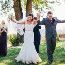 <strong class='info-row'>Zelo Photography</strong> <div class='info-row description'>The couple was all smiles during their recessional.     Venue: The Condor's Nest Ranch     Floral Design: Isari Flower Studio</div>