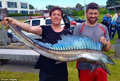 Cam Twigley (right) and his friend Nik Pyselman present the elusivelongsnout lancetfish w...