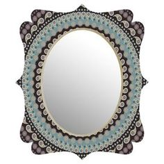 """Showcasing a quatrefoil-inspired frame and paisley motif, this chic wall mirror makes a striking statement.   Product: MirrorConstruction Material: Aluminum, mirrored glass and baltic birch plywoodColor: MultiFeatures:  Custom made for every orderMounting hardware includedDesigned by Belle13 of DENY Designs UV resistant coatingDimensions: Small: 19"""" H x 14"""" W x 1"""" DMedium: 29"""" H x 22"""" W x 1"""" D"""