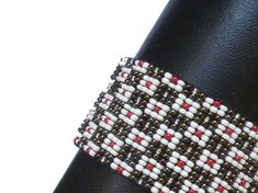 The original one of a kind bracelet. Made with high quality Czech glass seed beads.  Approx width: 1.18 ( 3cm ) Approx length: 5.12 ( 13cm ) Chains lenght: 2.95 ( 7.5cm ) Beads size: 11/00  The chain allows the bracelet to fit varying wrist sizes.  Inspired by Nature, Colors and Ornaments.  Free shipping.  Welcome to my graphic, drawing, collage, mixed media and painting shop too www.etsy.com/shop/KariatideLV